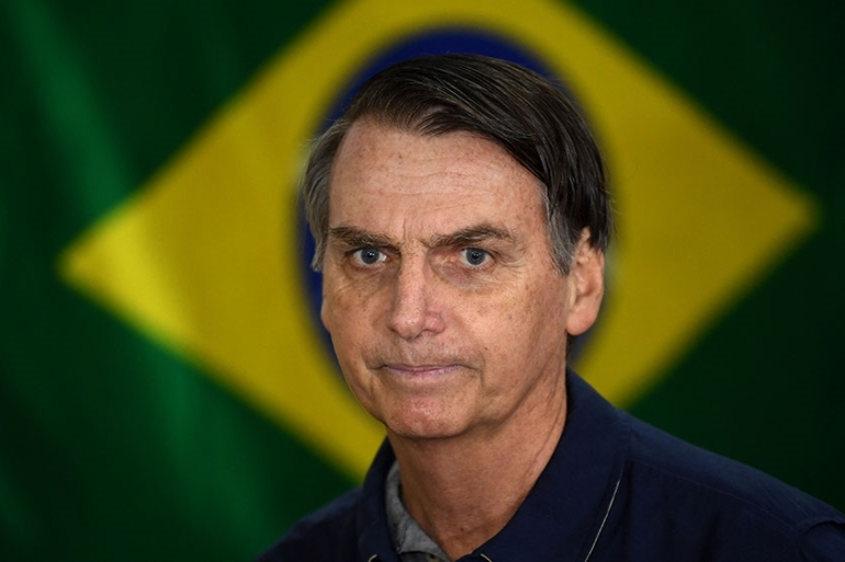 Bolsonaro currently leads opinion polls and is expected to win a comfortable victory during the October 28 presidential runoff against the Workers' Party's Fernando Haddad [File: Mauro Pimentel/AFP]