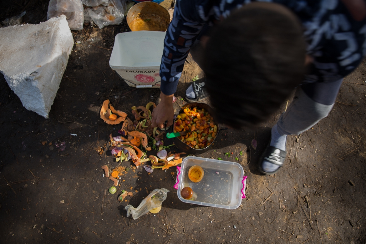 Their lunch often consists of a vegetable broth with some boiled eggs added, if the migrants have saved up enough money to afford them. [Faras Ghani/Al Jazeera]
