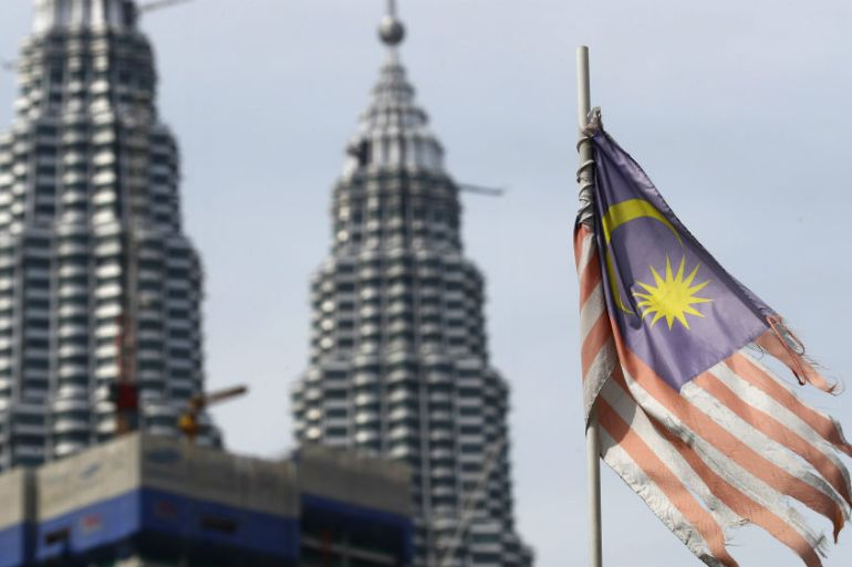 The governor of Malaysia's central bank said that it is 'not on any preset course' to lower interest rates, although analysts think it may have to do so to keep the economy growing [File: Vincent Thian/The Associated Press]