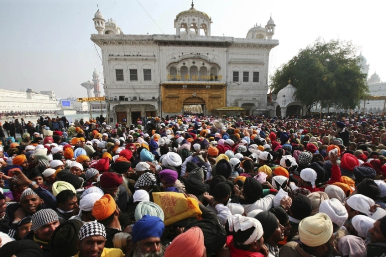 Riots erupted after Indira Gandhi's assassination for ordering troops into Golden Temple [File: Munish Sharma/Reuters]