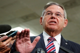 Senator Robert Menendez speaks to the media [Joshua Roberts/Reuters]