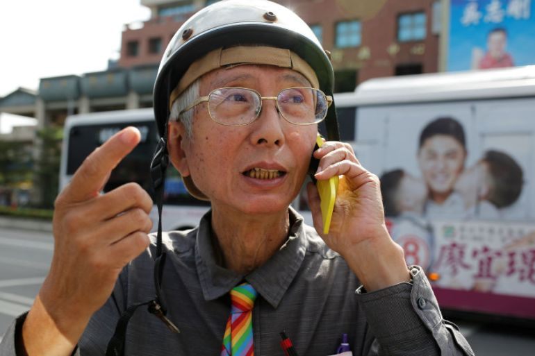 Gay rights activist Chi Chia-wei arrives to cast his vote in the referendum on same-sex marriage [Ann Wang/Reuters]