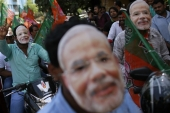 Supporters of Bharatiya Janata Party (BJP) wearing masks of Narendra Modi celebrate their party's election victory, in Mumbai May 26, 2014 [File:Danish Siddiqui/Reuters]