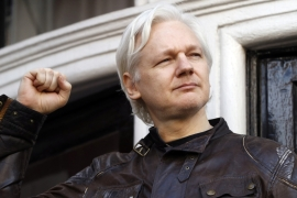 Julian Assange at the Ecuadorian Embassy in the UK [File: Frank Augstein/AP]