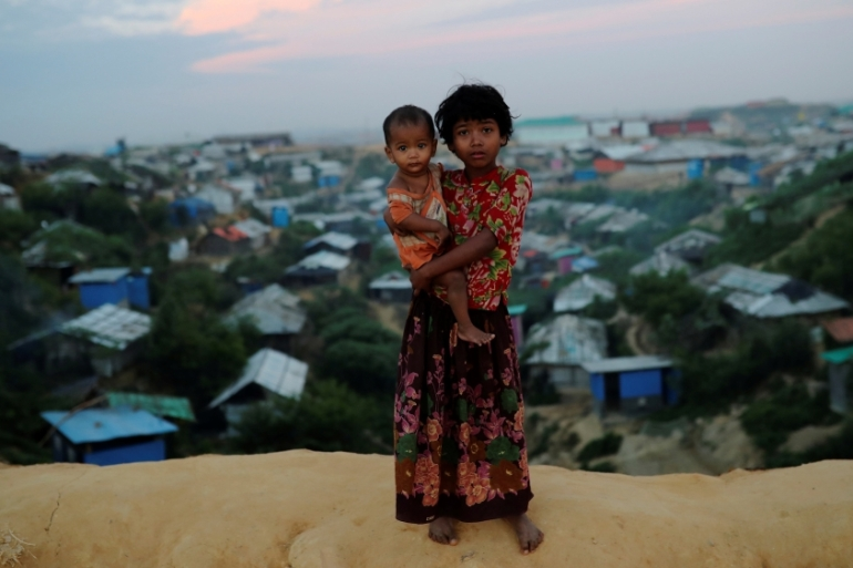 Rohingya refugee children pose for a picture at the Balukhali camp in Cox''s Bazar, Bangladesh, November 15, 2018 [Mohammad Ponir Hossain /Reuters]