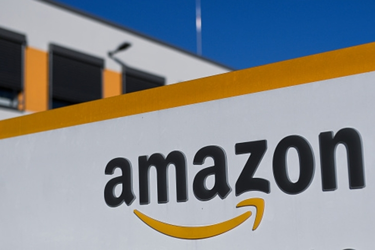 Amazon said the new offices would be 'full equal to its current campus in Seattle' [Ina Fassbender/Getty Images]
