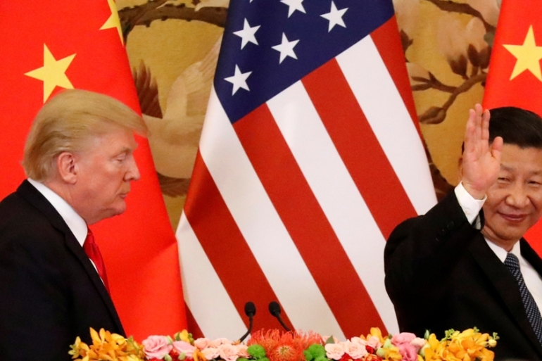 US President Donald Trump and China's President Xi Jinping make joint statements at the Great Hall of the People in Beijing, China, on November 9, 2017. [Jonathan Ernst/Reuters]