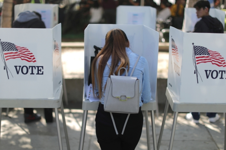 More than 31 million people voted early in the US midterm elections [Lucy Nicholson/Reuters]