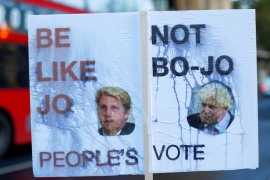 A placard in favour of a second Brexit referendum features pictures of former Foreign Secretary Boris Johnson, and former Transport Minister Jo Johnson, in London, UK November 12, 2018 [Reuters]