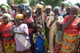 Women stand in line for food aid distribution delivered by the United Nations Office for the Coordination of Humanitarian Affairs and world food programme in the village of Makunzi Wali, Central African Republic [File: Baz Ratner/Reuters]