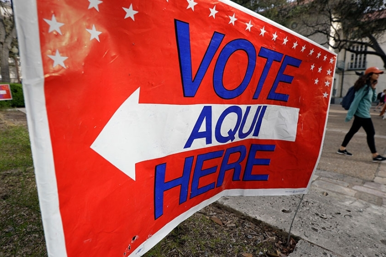 A sign directs voters to a Texas primary election polling site on the University of Texas campus [Eric Gay/AP Photo]
