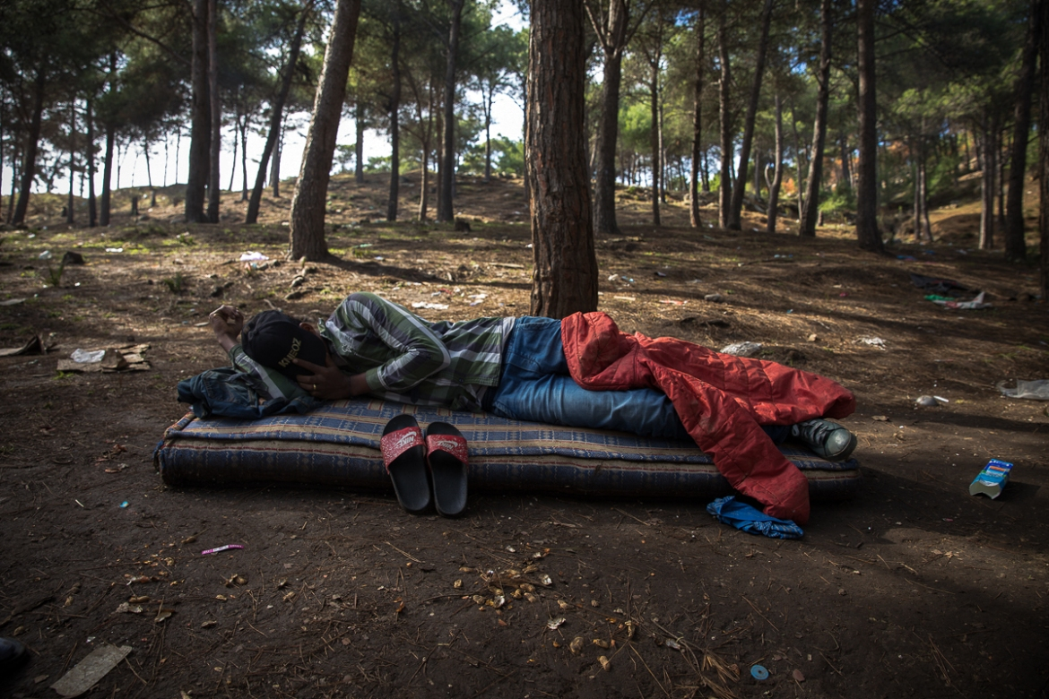 Sleeping on discarded mattresses, migrants often only possess only mobile phones and the clothes they are wearing. [Faras Ghani/Al Jazeera]
