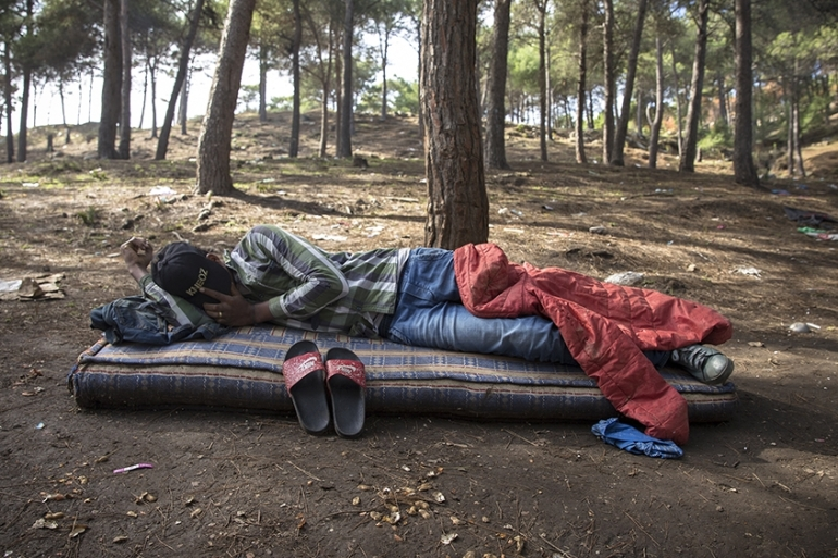 The forest in Tangier is often the last stop for many migrants from sub-Saharan African countries. The police routinely raids the forest, where migrants are sleeping under the trees, and takes them to the south of the country. [Faras Ghani/Al Jazeera]