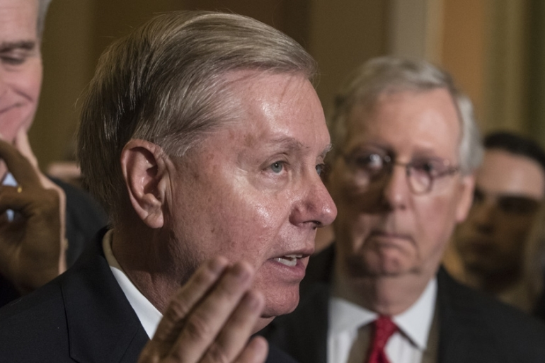 Lindsey Graham, reassured that Trump is committed to defeating ISIL group even as he plans to withdraw American troops fro Syria [File: J. Scott Applewhite/AP]