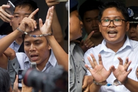 Kyaw Soe Oo, left, and Wa Lone are serving a seven-year sentence for violating Myanmar's colonial Official Secrets Act [Thein Zaw/AP]
