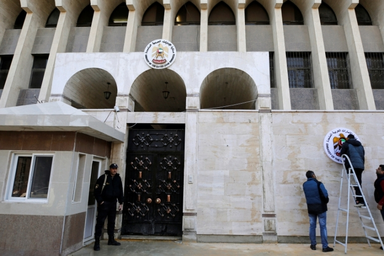 A security guard stands in front of the UAE embassy in Damascus during its reopening [Omar Sanadiki/Reuters]