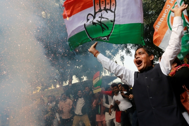 Supporters of the Congress party celebrate election results [Adnan Abidi/Reuters]