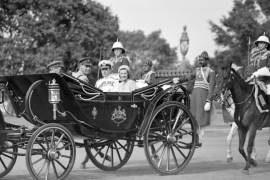 Lord Louis Mountbatten, the last Viceroy of India, and his wife, Lady Edwina Mountbatten, ride in the state carriage towards the Viceregal lodge in New Delhi, on March 22, 1947 [File: AP]