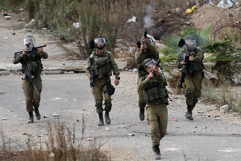 Israeli forces intervene during a Palestinian demonstration held in Tulkarem in December 2017 [Nedal Eshtayah/Anadolu Agency/Getty Images]