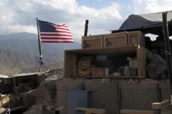 US flag is seen at a post in Deh Bala district, Nangarhar province [File: James Mackenzie/Reuters]