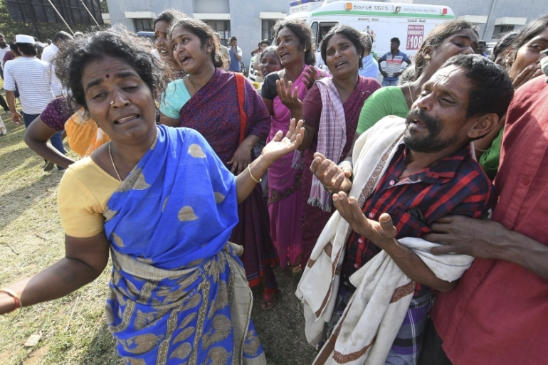 Indians mourn the death of relatives in a case of suspected food poisoning in southern India  [Madhusudhan Sr/AP Photo]