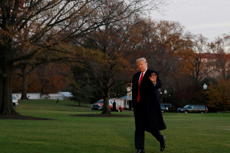 President Donald Trump walks across the South Lawn after returning to the White House in Washington [Jim Young/Reuters]
