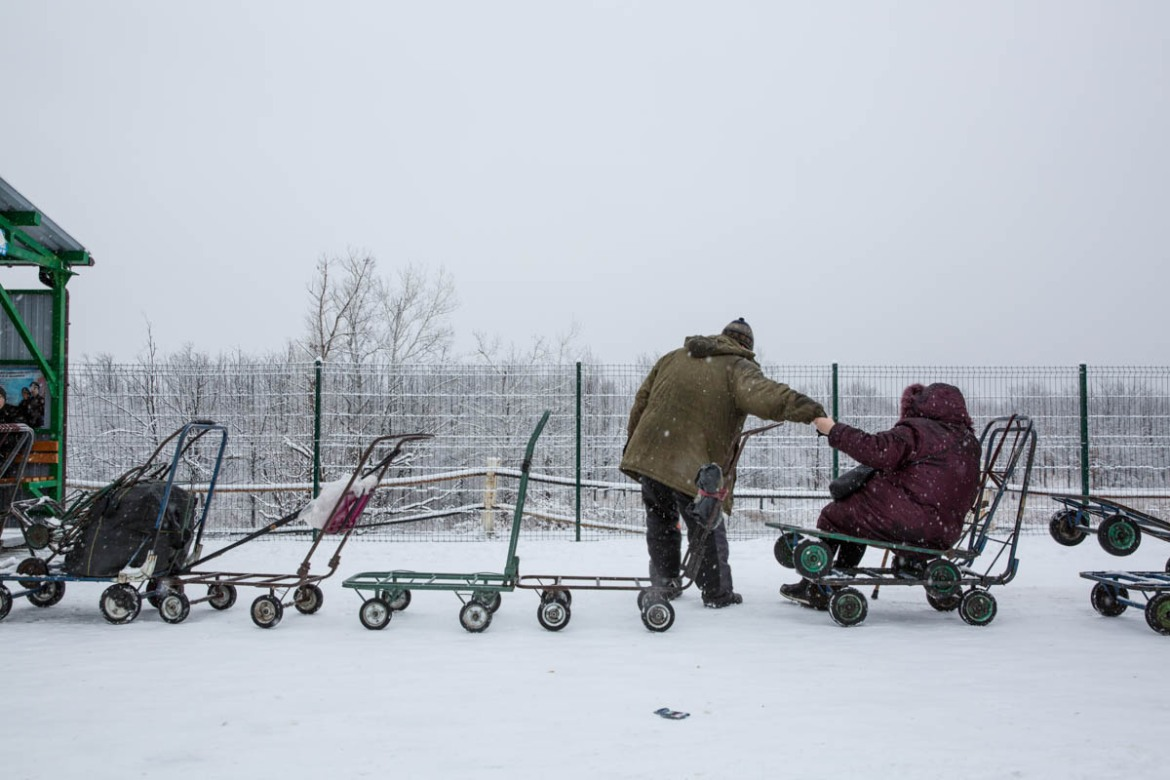 To receive pension and other social benefits, inhabitants living in the non-government-controlled areas have to show up in person in the government-controlled areas every month. The journey is long, exhausting and costly. 'Nobody worries about us. We are forgotten here,' said Halyna, 58. [Ingebjorg Karstad/Norwegian Refugee Council]