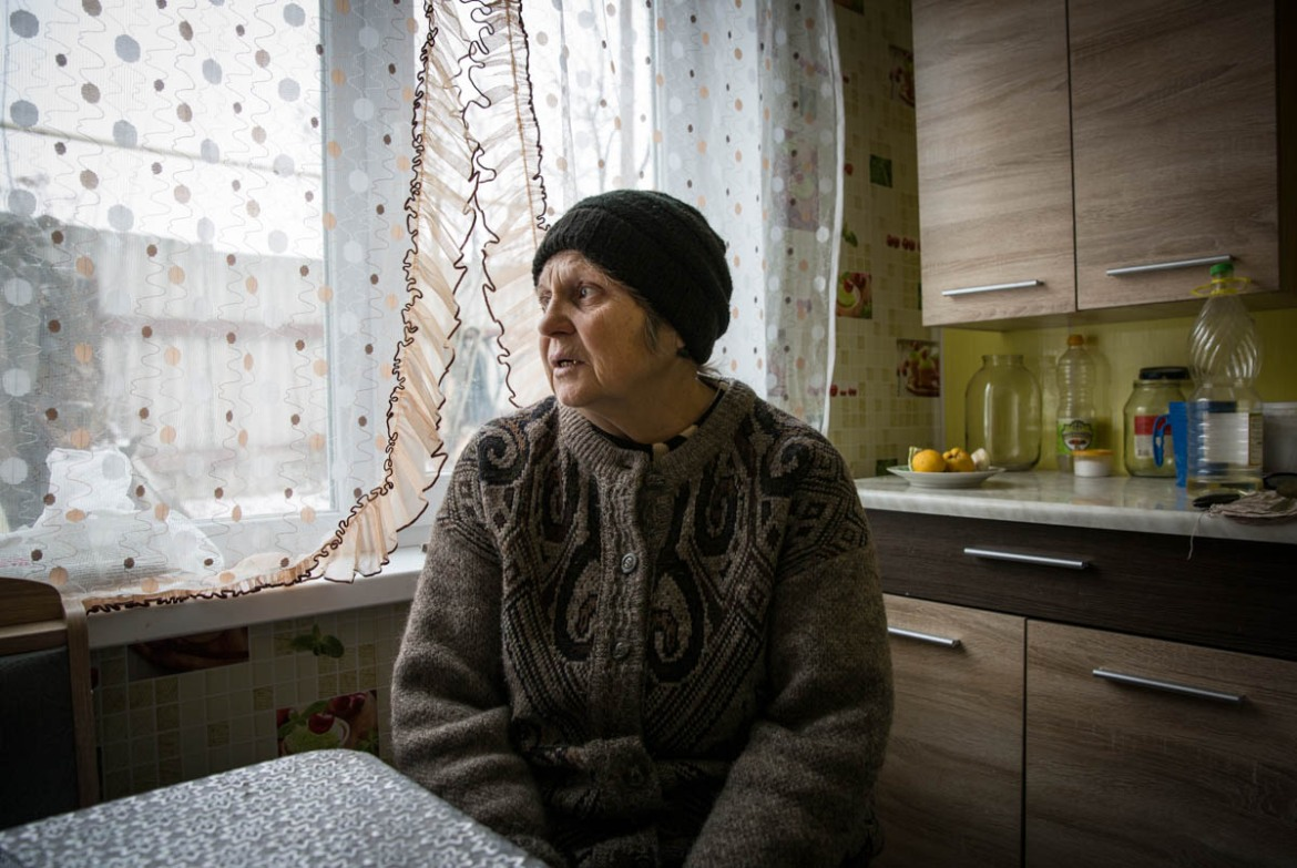 'I was living with my husband Mykola for many years in Zolotarivka village. I worked as a storekeeper, my husband worked as a plumber. We brought up three children. We had everything we needed for a normal and stable life: a house, car, walking tractor, cow, pigs, chickens,' said Liudmyla. Her village became one of the first hotspots of armed conflict in eastern Ukraine. 'On 17 July 2014, during the night, we had very heavy shelling. One of the shells hit our house and completely destroyed it. Our house was burning for three days. Only one chicken remained alive. We lost everything we had. When we went out from the bombed shelter and my husband saw all this, his legs failed him. We took him to the hospital, and they diagnosed him with cancer.' [Ingebjorg Karstad/Norwegian Refugee Council]