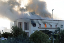 Smoke rises from the headquarters of Libya's foreign ministry in Tripoli [Hani Amara/Reuters]