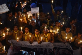 Students lit candles to pay tribute to the victims of the Peshawar school massacre [File: Rana Sajid Hussain/Pacific Press/Getty Images]