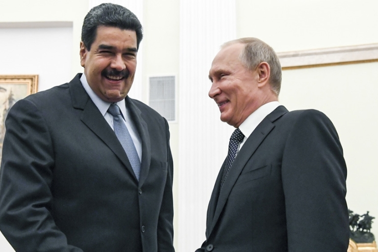 President Maduro visited President Putin last year, and is on his way to make a second visit now [FILE: Yuri Kadobnov/AP]