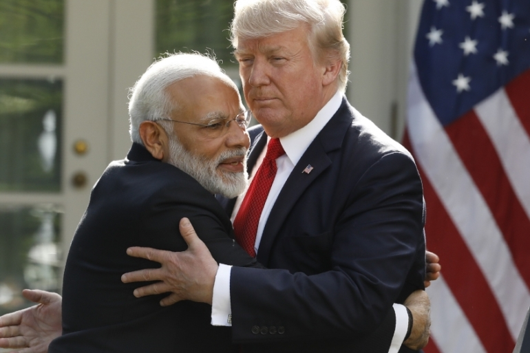 India's Prime Minister Narendra Modi hugs US President Donald Trump as they give joint statements in the Rose Garden of the White House in Washington, US, June 26, 2017 [Kevin Lamarque/Reuters]