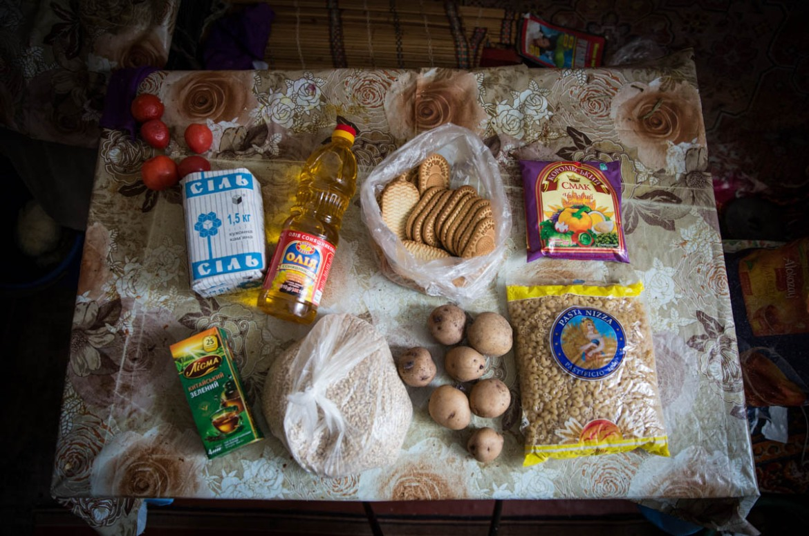 'We have 300-400 UAH ($11-15) to spend on food per week. This is enough to buy bread, sunflower oil, some potatoes and the cheapest cereal. Our regular lunch is soup and porridge. I can't remember the last time I ate meat,' Oleksandr said. [Ingebjorg Karstad/Norwegian Refugee Council]