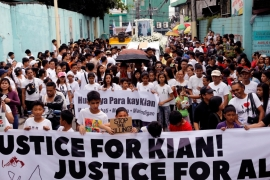 Mourners seen at a funeral march for Kian Delos Santos, the 17-year-old student who was shot during anti-drug operations in Manila, Philippines, on August 26, 2017 [Erik De Castro/Reuters]