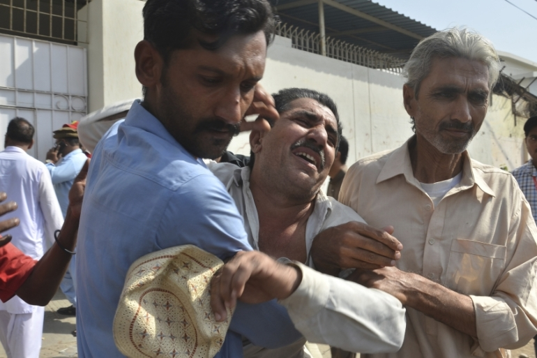 Seven people were killed in the November attack on the Chinese consulate in Karachi [File: Shakil Adil/AP Photo]