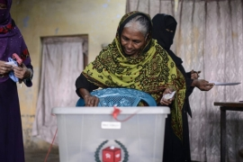 A woman casts her vote during the general election in Dhaka, Bangladesh [Mahmud Hossain Opu/Al Jazeera]