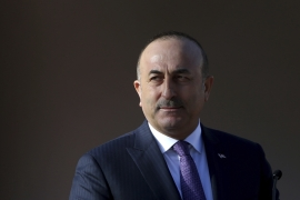Turkish Foreign Minister Mevlut Cavusoglu said Ankara would go ahead with its incursion plan [File: Petros Karadjias/AP]