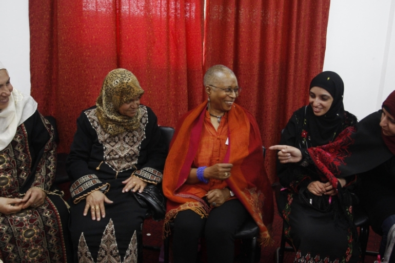 Pulitzer-prize winning author Alice Walker talks with Palestinian women during a visit in Beit Hanoun in the northern Gaza Strip on March 8, 2009 [File: AP Photo/Hatem Moussa]