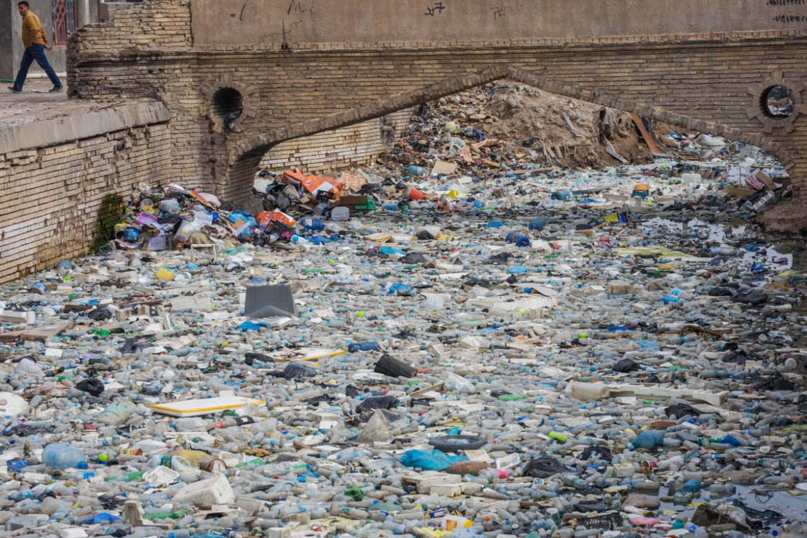 Al-Ashar River, one of the canals in Basra's Old City, derives from Shatt al-Arab River. These days, Basra's canals such as al-Ashar have been turned into rubbish dumping sites. [Alessio Mamo/Al Jazeera]