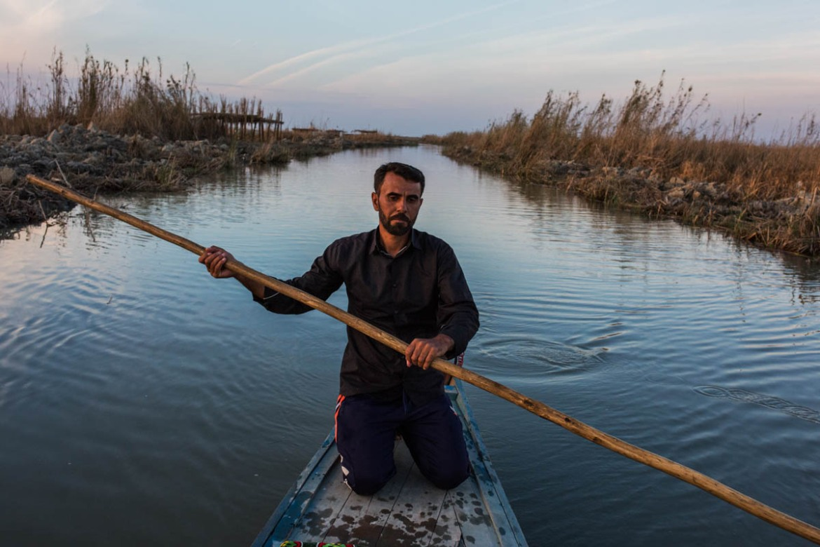 Hussein lives with his family in Ahwar in the Mesopotamian marshes. The Arab population of the marshlands is called Ma'dan. But many of them have been forced to leave the area due to the harsh conditions. Hussein fishes in the marshes and gives rides to tourists on his zawarq, the small boat he rows. In 2016, the UNESCO named the Iraqi marshlands a world heritage site. [Alessio Mamo/Al Jazeera]