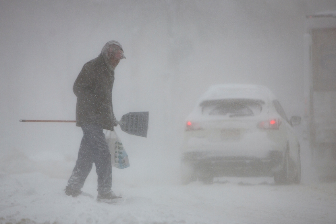 A man crosses the street during a winter  storm in Buffalo, New York. [Lindsay Dedario/Reuters]