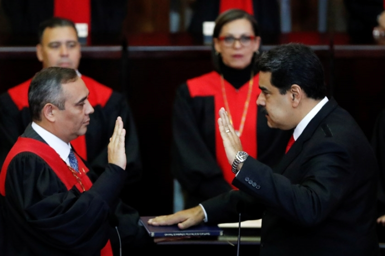 Maduro has accused his critics of plotting a coup [Carlos Garcia Rawlins/Reuters]