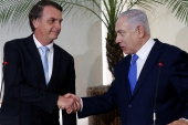 Brazil's President Jair Bolsonaro seen with Israeli Prime Minister Benjamin Netanyahu during a meeting in Rio de Janeiro, Brazil on December 28, 2018 [File: Fernando Frazao/Agencia Brasil/Reuters]