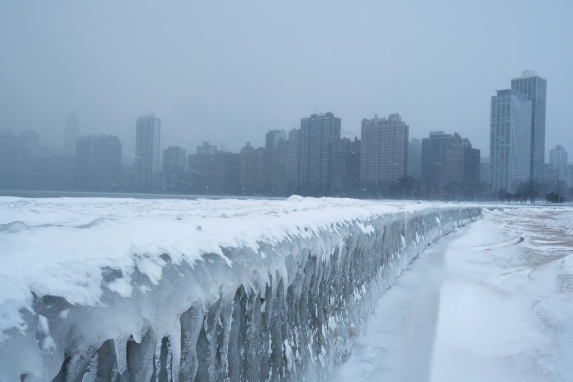 A walkway in Chicago covered in ice on Lake Michigan. [Pinar Istek/Reuters]