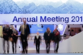 People walk upstairs at the Davos Congress Centre where the annual meeting of the World Economic Forum 2019 takes place, January 20, 2019 [Markus Schreiber/AP]