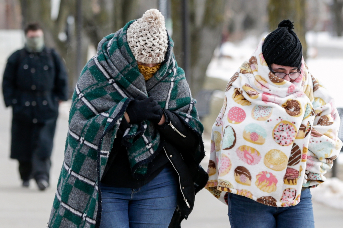 The record-breaking temperatures triggered widespread closures of schools and businesses, and the cancellation of more than 1,600 flights. [Nati Harnik/AP Photo]