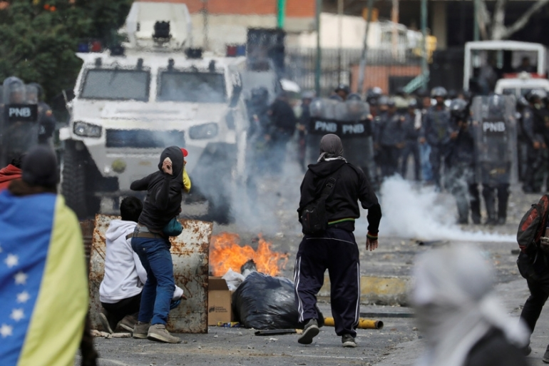 Demonstrators clash with police during a protest against Venezuelan President Nicolas Maduro's government in Caracas [File: Manaure Quintero/Reuters]