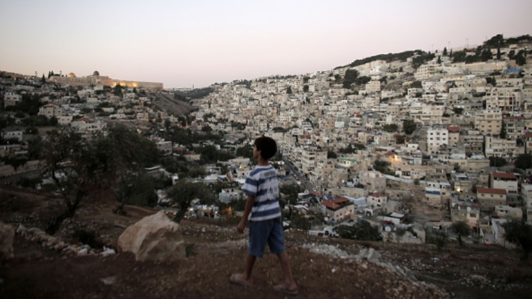 ISRAEL-PALESTINIAN-CONFLICT-JERUSALEM A picture taken on October 21, 2014 shows the Dome of the Rock in the Al-Aqsa mosque compound (L) and the east Jerusalem neighborhood of Silwan,