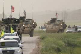 Kurdish fighters from the People's Protection Units (YPG) head a convoy of US military vehicles in the town of Darbasiya next to the Turkish border [File: Rodi Said/Reuters]