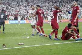 Qatar's players were pelted with shoes and bottles during the match on Tuesday [Hassan Ammar/AP]